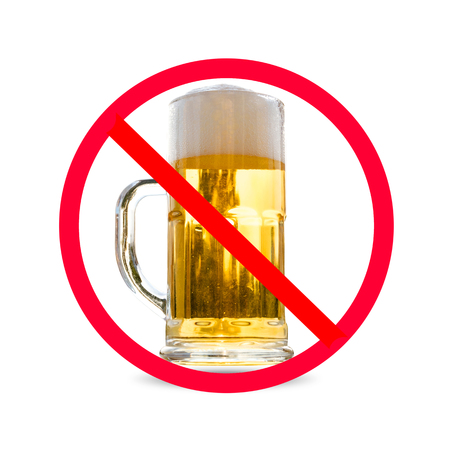 The red circle with slash on glass of beer isolated on white background ; Concept for do not drink alcohol. Stock Photo