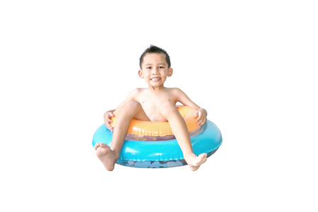 Cute Asian boy sitting on the colorful swim rings isolated on white background.