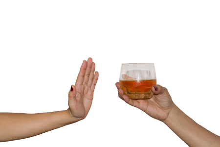 Womans hand extended glass drink alcohol on the other hand rejected on white background. concept for dont drink and drive. Stock Photo