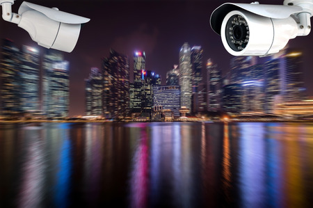 closed circuit television: CCTV or surveillance camera  on the colorful night city background.