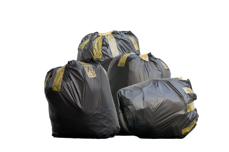 Group of black garbage bags put fully covered with adhesive tape isolated on white background.