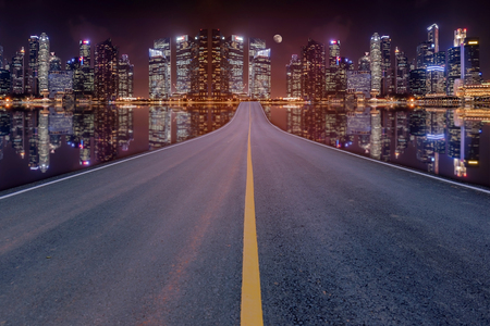 blacktop: Lane blacktop in the colorful night cityscape with beautiful skyscrapers background.
