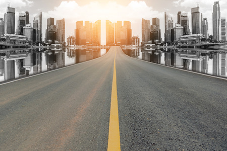 blacktop: Lane blacktop in the colorful city with beautiful skyscrapers background. Stock Photo