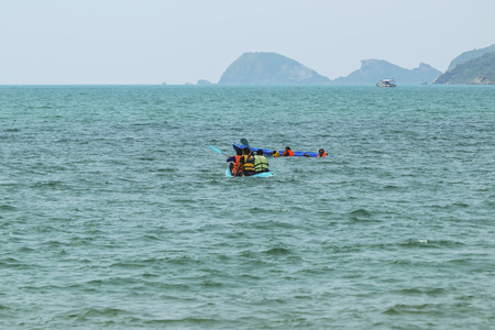 Chon Buri,Thailand-Feb 21,2016:Travelers canoeing on the sea and enjoy the holiday.