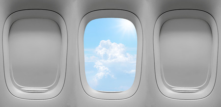 Closeup group of the airplane windows with the clouds sky background. Archivio Fotografico