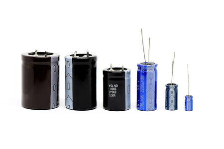 capacitance: Group of capacitors different sizes isolated on white background.
