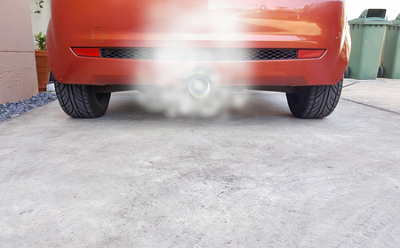 exhaust system: Closeup the smoke coming out of the exhaust system in stainless steel cars. Stock Photo