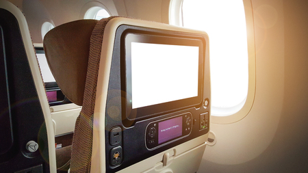 Closeup LCD rear seat on the plane technology for entertainment.