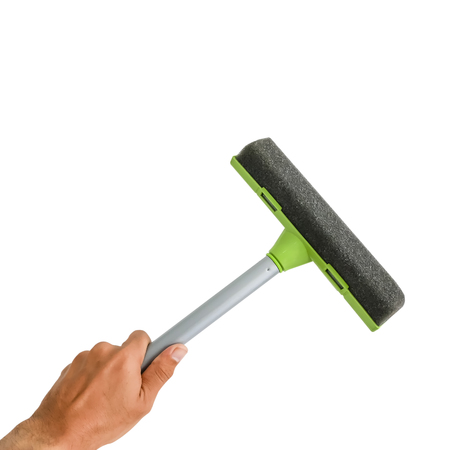 Glass cleaner tool in hand isolated on white background with clipping path.