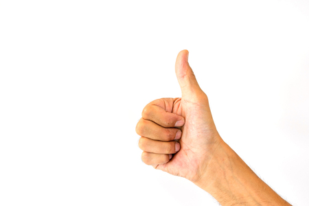 The thumbs up of a man's thumb is like a symbol or a compliment isolated on white background. Standard-Bild