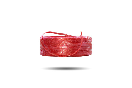 Row of red plastic rope for binding various items isolated on white background.