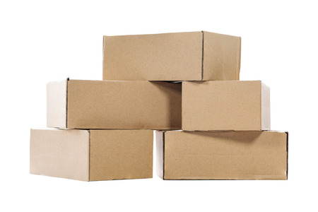 Stack of empty paper boxes for product packaging and delivery isolated on white background.