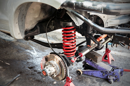 The front wheel of the car was removed to repair the brake system, Automotive industry and garage concepts.