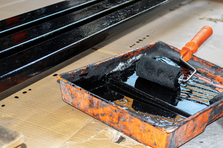Rolling steel painted in the painted tray with black color.