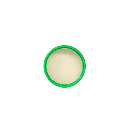 Green plastic bottle cap isolated on white background.