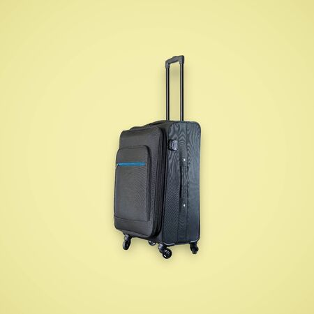 Black suitcase isolated on beautiful pastel color background, with clipping path.