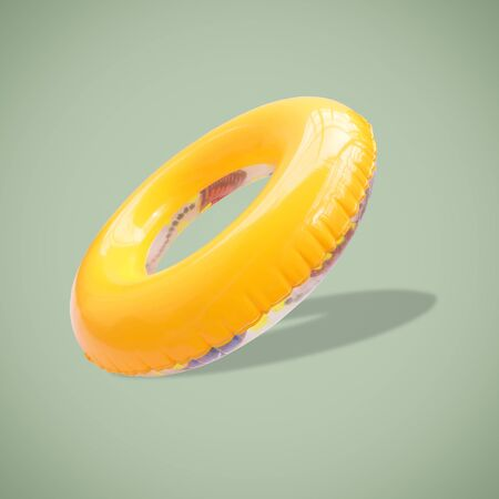 Yellow color swim rings isolated on beautiful pastel color background, with clipping path.