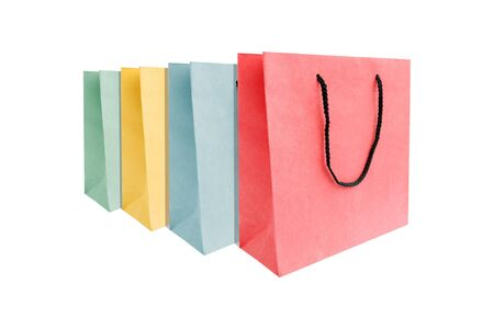 Group of multi colored of paper shopping bags isolated on white background.