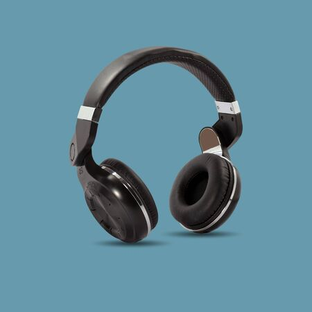 Black wireless headphone isolated on beautiful pastel color background, with clipping path.