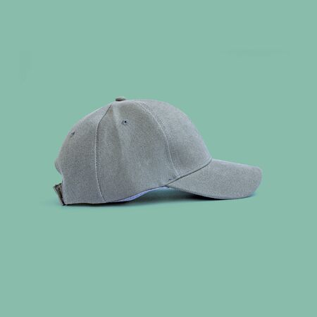 Fashion and sports grey cap isolated on beautiful pastel color background, with clipping path.