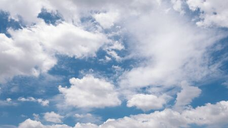 Beautiful white clouds and blue sky in the summer day.