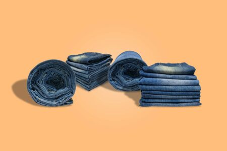 Rows and stacks of of blue jeans long legs for men and  isolated on pastel color background with  .