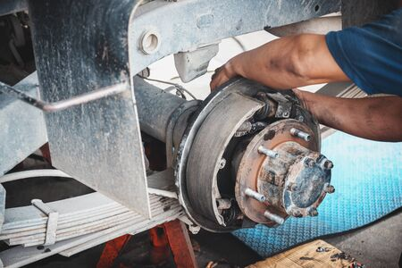 Technicians remove the wheels of the car to repair the rear brakes of the car.