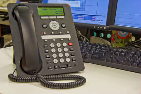 Modern digital IP phone on office.  photo