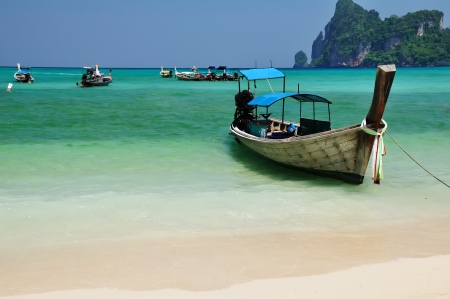 Boat on the beach,Loh Dalam Bay,ko Phi Phi island Thailand  photo