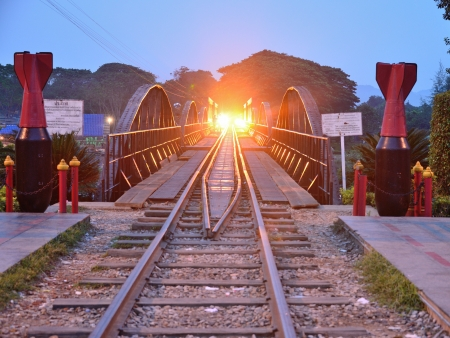The electricity illuminates on railway river Kwai bridge Kanchanaburi province. photo
