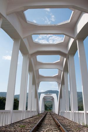 tha: Tha chom phu white bridge ( white railway bridge) Lamphun Thailand.