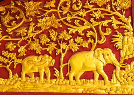 crave: Thai traditional carving decoration on the wall at Jom Por Temple,Chiangrai north Thailand.