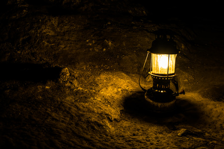 lamplight: Ancient lantern ( Oil lamp ) on the ground.