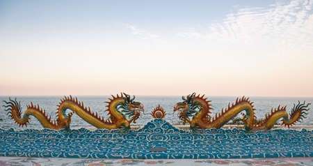 Dragons statue beside the Gulf of Thailand photo