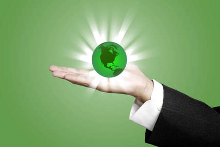 Green World with Business Hand concept photo