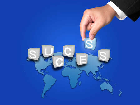 Business Hand and Success word on blue background photo