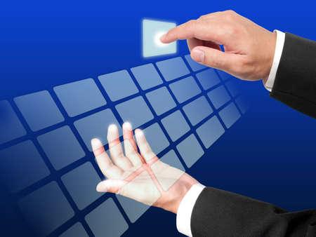 pushing the button: Manos de negocios presionando el bot�n en fondo azul Foto de archivo