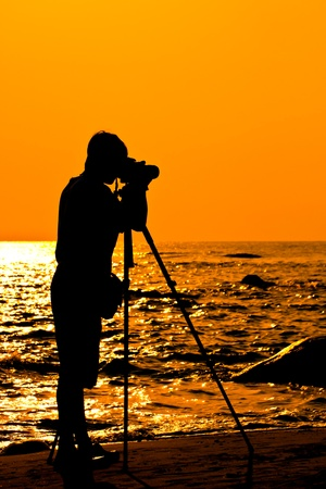 Silhouette Photographer on the beach, Thailand photo