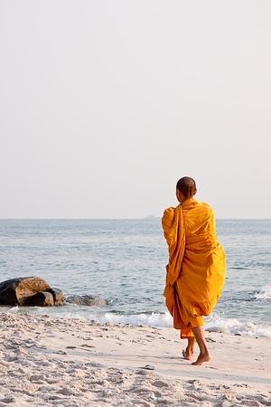 Monk walking on the beach, Thailand Stock Photo - 12885940