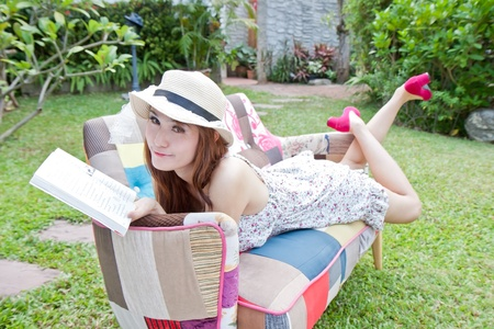 Beautiful asian woman reading her book in the garden Stock Photo - 13542391