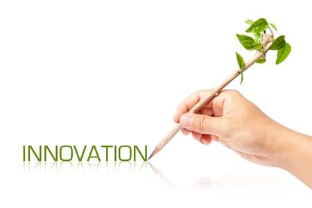 Innovation wording with creative pencil with green tree on white backgorund photo