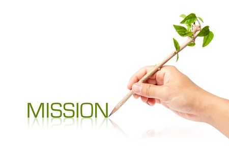 Mission wording with creative pencil with green tree on white backgorund Stock Photo