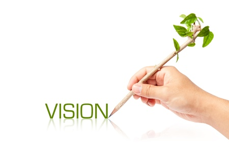 Vision wording with creative pencil with green tree on white backgorund photo
