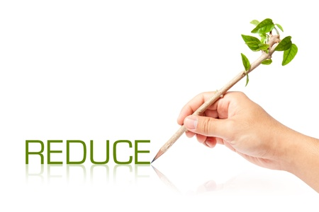 Reduce wording with creative pencil with green tree on white backgorund photo