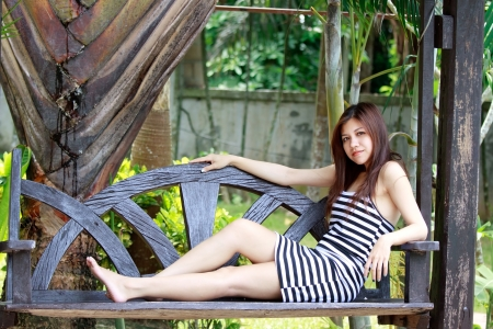 Asian woman relaxing beside the garden photo