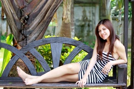 Asian woman relaxing beside the garden Stock Photo