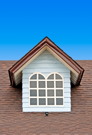 Brown roof on blue sky photo
