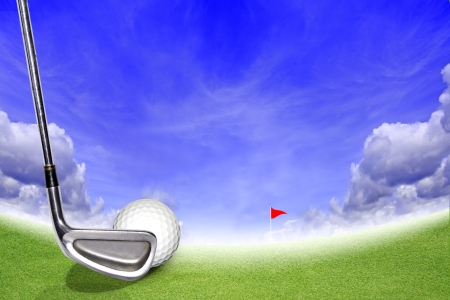Golf Stick and Ball on the Green Grass and Blue Sky