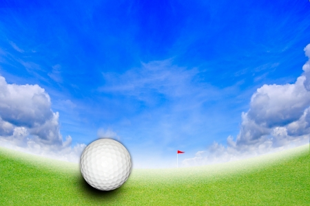Golf ball at the hole on the golf course on blue sky photo