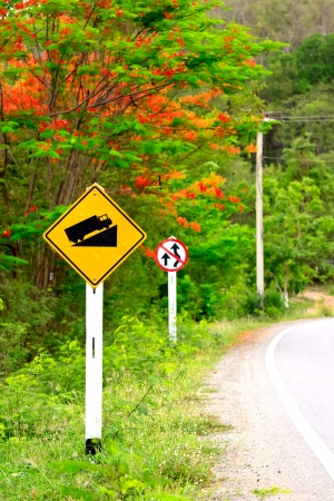 Road sign beside the main road go to the mountain photo